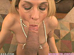 Let Angela this suburban MILF suck your cock.  She takes off her bra for you as her pearl necklace (the jewelery kind) slaps against her tits.  She plays with her clit because she gets so fucking turned on sucking your dick.  She talks about all the lingerie she wants to wear for you as you shove your manhood down her throat until it bounces off the back of her neck.