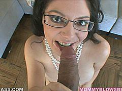 An experienced older woman knows the art of the tease. Kiki Daire is a sensual MILF who loves lacy lingerie and a pearls. Her lacy bra cups a pair of natural boobs and creates a deep cleavage for her pearls (and your cock) to get lost in. Kiki gets on her knees and plays with her boobs while she sucks this big cock into her mouth. She's a playful MILF who likes to talk dirty when she doesn't have her lips stuffed with manmeat. She puts her whole body into this blowjob -- squeezing it between her amazing boobs and moving her mouth up and down his cock until he gives her the real pearl necklace she deserves.