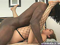 This is a truly magical scene and it represents everything we want to show you when it comes to big cock interracial sex.  It looks fucking awesome to see this big black dude on top of this white chick in her black lingerie.  She is so hot for this guy that she can't get enough of this big monster cock!  This guy will fuck for hours with that beast of his and never get bored; he is the girls' favorite