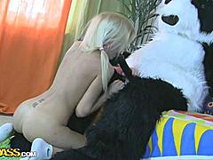 This pretty teen girl and her panda bear sure have much fun together! They listen to the music, sing along and dance. But why not doing something kinkier than just dance? So the blondie strips naked, playing with a large dildo. This makes the panda bear horny as hell, and luckily, he has something to satisfy his nasty friend's lust! A big strapon is ready to pierce the girl's oozing hole, to make her forget about everything and plunge into salacious fun fucking. This fantastic teenporn video is sure to blow you away!