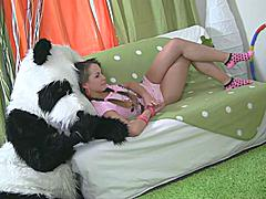 In this unusual sex video you'll see a beautiful teenage girl playing with toy. But it's not just a toy, it's a big panda bear, and he's so fun to play with! He can do anything the girl wants, but she should strip naked in return. But imagine the girl's surprise when she saw panda's huge strap on! She had never thought of him as sex partner before, but since he's so well-equipped and horny, why not go for a nasty sex play with him? So the panda bear banged the busty teenage in all possible positions ...