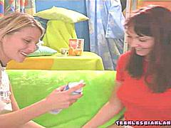Horny lesbian girls lick and kiss their clits at a birthday party