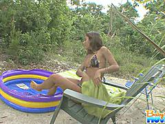 Latina babysitter with big tits and huge ass shaving in back yard