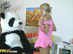 This pretty teen girl and her panda bear sure have much fun together! They listen to the music, sing along and dance. But why not doing something kinkier than just dance? So the blondie strips naked, playing with a large dildo. This makes the panda bear horny as hell, and luckily, he has something to satisfy his nasty friend's lust! A big strapon is ready to pierce the girl's oozing hole, to make her forget about everything and plunge into salacious fun fucking. This fantastic teenporn video is sure ...