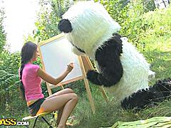On a sunny summer day a pretty artist decided to go to the woods to paint a beautiful landscape picture. But her plans were ruined when she saw a huge panda bear coming near her. However, he turned out to be so cute and playful, the teenage hottie forgot about her painting and even let him take her clothes off. And then she saw panda's strap on penis, and there was only dirty sex on her mind. The girl spread her legs wide, letting the horny bear drill her oozing pussy with that awesome megadildo of his.
