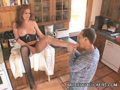 Redhead hottie Morgan now bares her sexy feet and legs as she removes her stockings. Her horny hottie can't keep his eyes away from her perfect feet and gives it a nibble. He gets hot and hard as he pleases her. Her humongous boobies jiggle with delight.