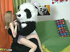 Oh, what a nice panda bear! He's got a present for this beautiful teenage girl - a brand new photo camera! Why not have a photo session? With every photo the girl gets hornier and hornier, and soon she poses naked shamelessly. But hey, panda wants some reward for his gift, something like kinky sex. And the panda's well equipped for that! An enormous dildo is always ready for some action! So the camera's forgotten, and the busty teenage happily rides the strapon cock of her lustful fluffy friend.