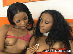 Two hot ebony in lingeries open this scene by showing off their tits and making out. One of them has the nicest looking booty while the other's a charming black beauty with a dildo in her hand and gets down to some serious action and toy fucked their slits.