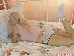 Beautiful lesbian teenies Abbyand and Bryana playing with strapon